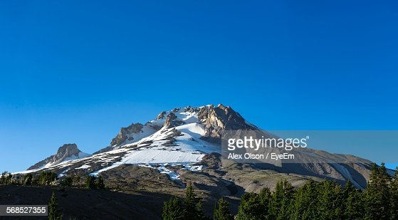 Low Angle View Of Mt Hood Against Clear Blue Sky
