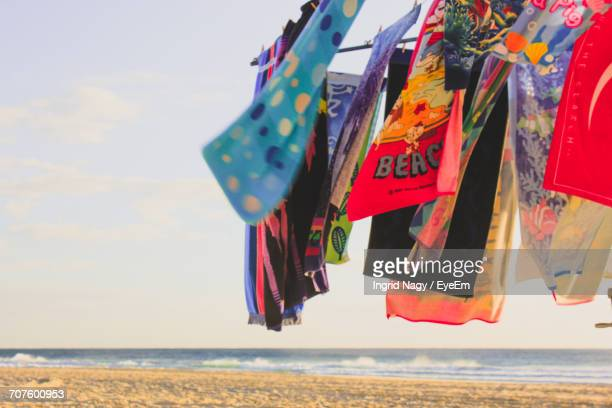 Low Angle View Of Multi Colored Umbrellas Hanging On Beach