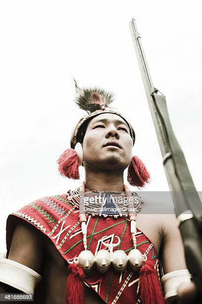 Low angle view of Naga tribal warrior in traditional outfit Hornbill Festival Kohima Nagaland India
