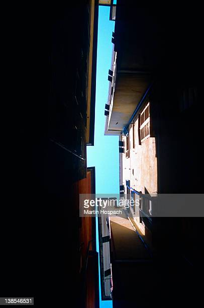 Low angle view of narrow space between two buildings