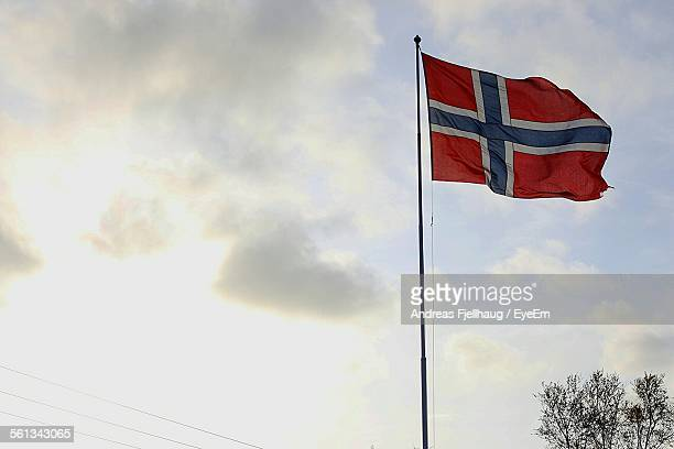 Low Angle View Of Norwegian Flag Against Sky