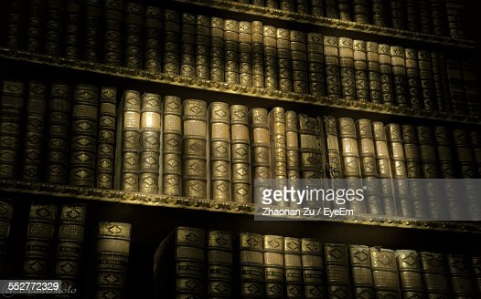 Low Angle View Of Old Books On Shelf