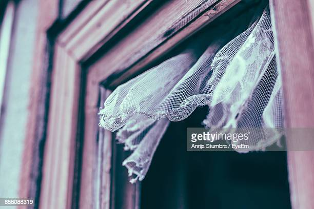 Low Angle View Of Old Curtain Hanging From Window