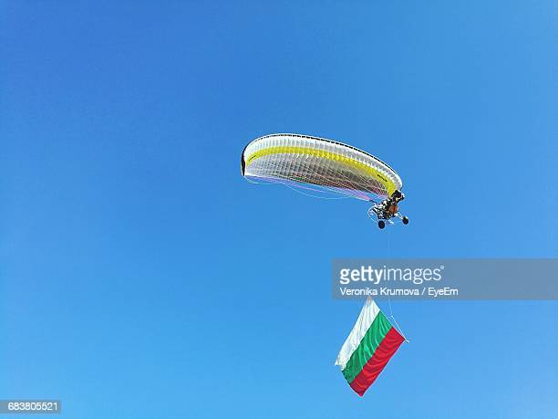 Low Angle View Of Paraglider In Mid Air With Bulgarian Flag