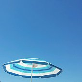 Low Angle View Of Parasol Against Clear Blue Sky