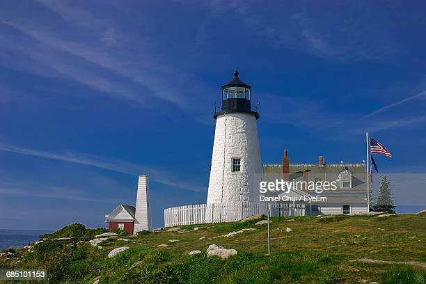 Low Angle View Of Pemaquid Point Light And American Flag Against Blue Sky