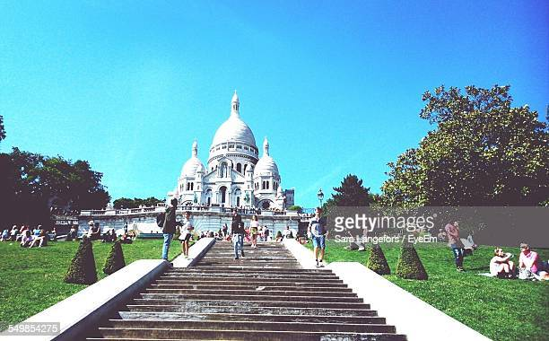 Low Angle View Of People In Basilique Du Sacre Coeur Against Clear Blue Sky