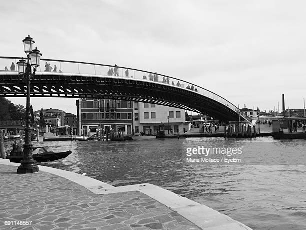 Low Angle View Of People On Ponte Della Costituzione Over Grand Canal