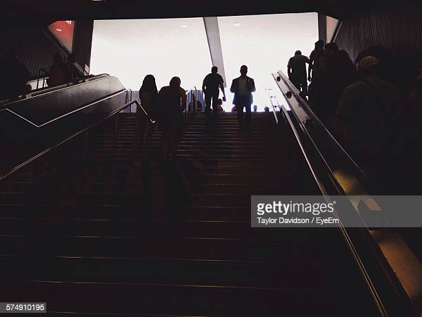 Low Angle View Of People Walking On Staircase At Subway