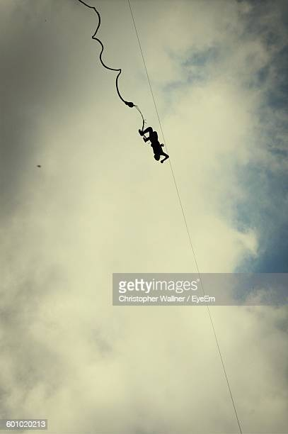 Low Angle View Of Person In Mid-Air While Bungee Jumping Against Sky