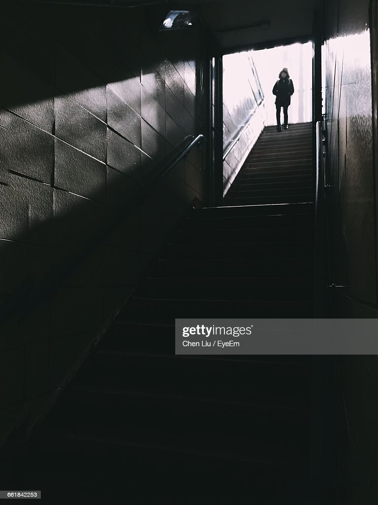 Low Angle View Of Person Standing On Staircase