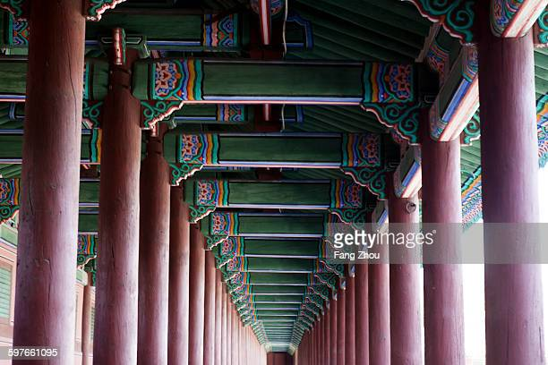 Low angle view of pillars and pagoda ceiling, Korea, Seoul
