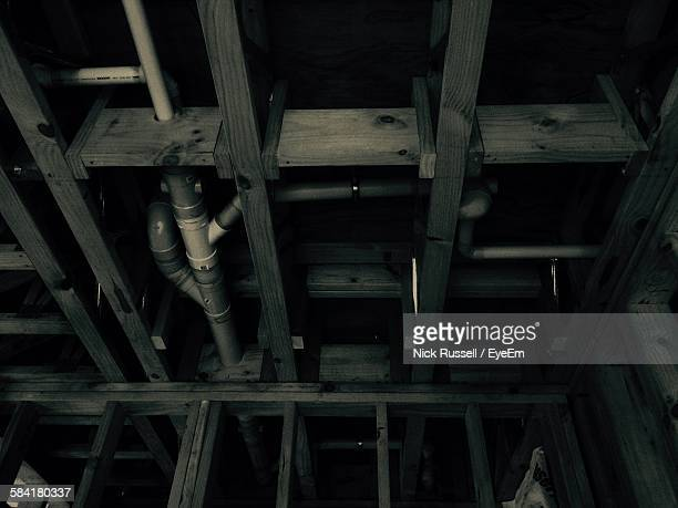Low Angle View Of Pipe On Wooden Ceiling
