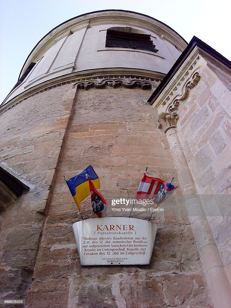 Low Angle View Of Placard On Historic Church : Stock-Foto