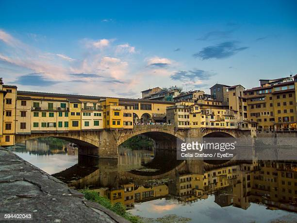 Low Angle View Of Ponte Vecchio On Arno River Against Sky