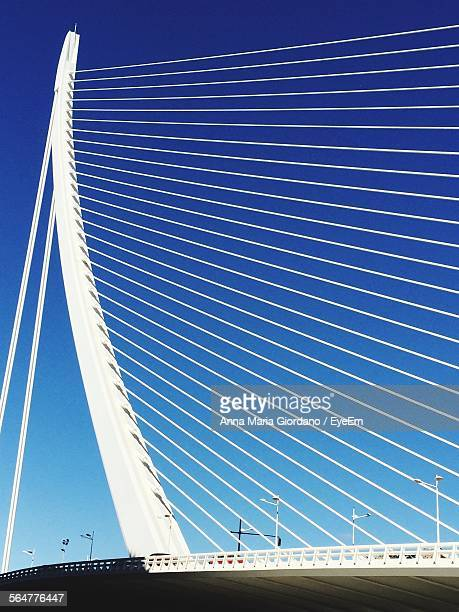 Low Angle View Of Puente Del Alamillo Bridge Against Blue Sky