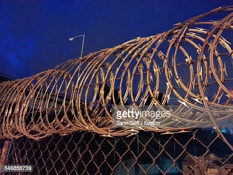 Low Angle View Of Razor Wire Against Sky At Night