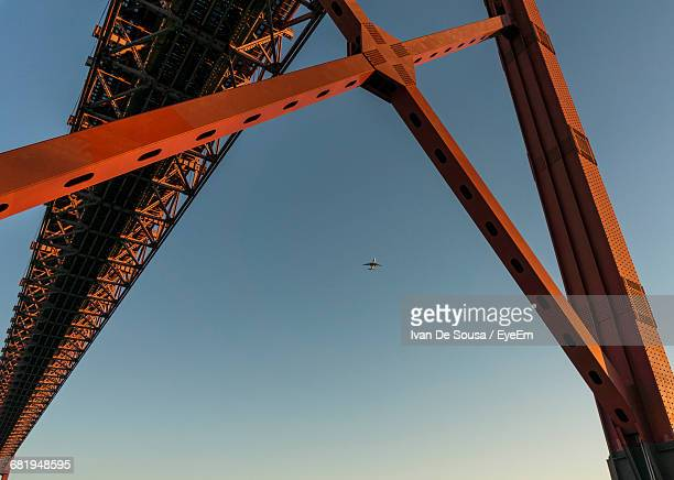 Low Angle View Of Red Bridge Against Clear Sky