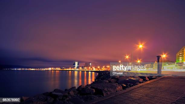 Low Angle View Of Reykjavik City And Its Harbour At Night