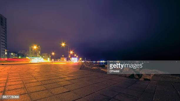 Low Angle View Of Reykjavik City At Night After Rain