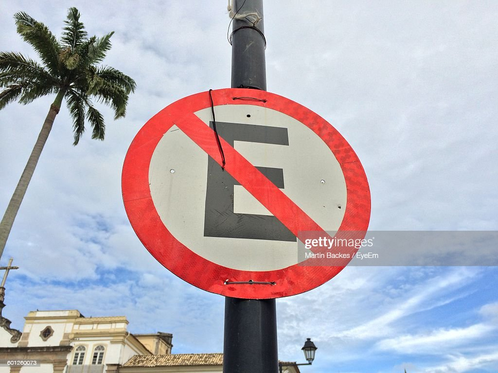 Low Angle View Of Road Sign On Pole Against Sky
