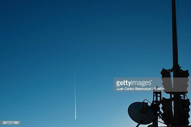 Low Angle View Of Road Signal With Satellite Dish