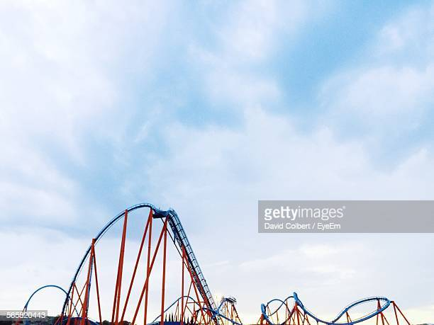 Low Angle View Of Rollercoaster Against Cloudy Sky