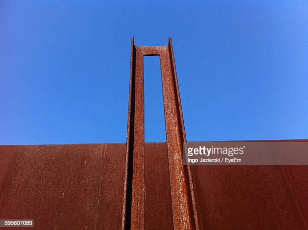 Low Angle View Of Rusty Metal Against Clear Sky