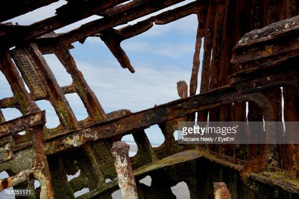 Low Angle View Of Rusty Shipwreck Against Sky