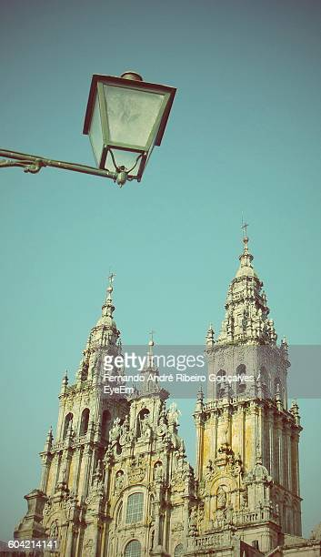 Low Angle View Of Santiago De Compostela Cathedral And Street Light Against Sky