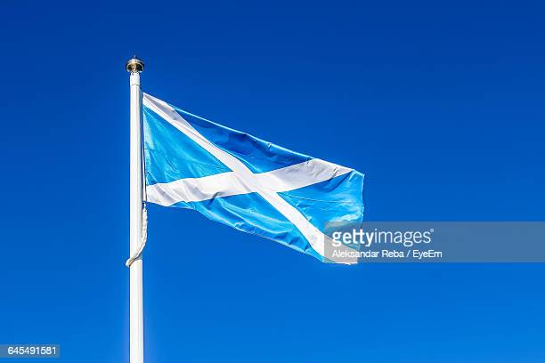 Low Angle View Of Scottish Flag Against Clear Blue Sky