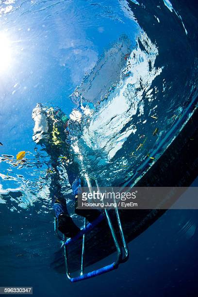 Low Angle View Of Scuba Diver In Sea