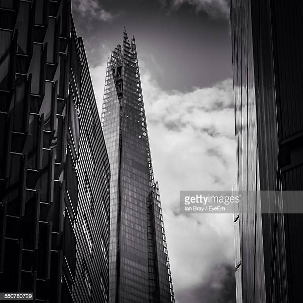 Low Angle View Of Shard London Bridge Against Cloudy Sky