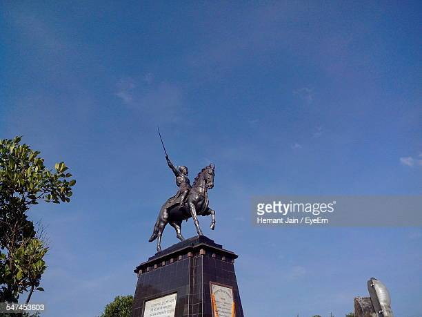 Low Angle View Of Shivaji Statue Against Blue Sky