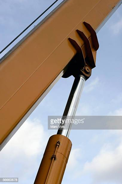 Low angle view of shock absorbers supporting a huge beam of a crane