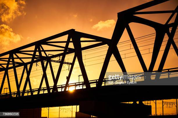 Low Angle View Of Silhouette Bridge Against Sky During Sunset