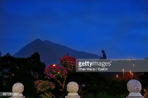 Low Angle View Of Silhouette Buddha Statue At Po Lin Monastery