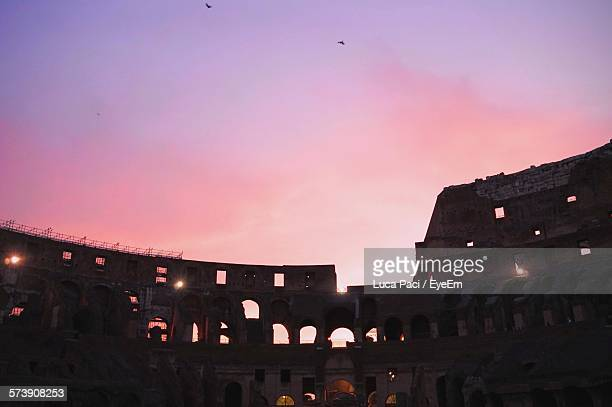 Low Angle View Of Silhouette Coliseum Against Sky At Sunset