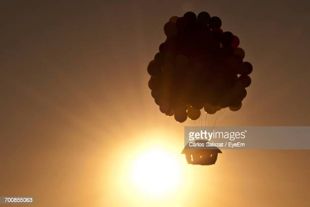 Low Angle View Of Silhouette Hot Air Balloon Against Sky During Sunset