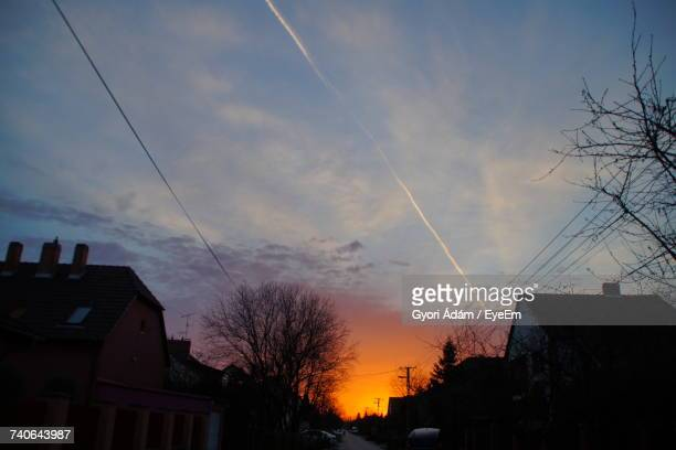 Low Angle View Of Silhouette Houses Against Sky At Sunset