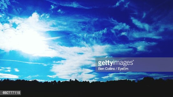 Low Angle View Of Silhouette Landscape Against Blue Sky