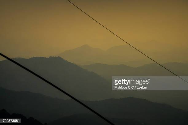 Low Angle View Of Silhouette Mountains Against Sky At Sunset