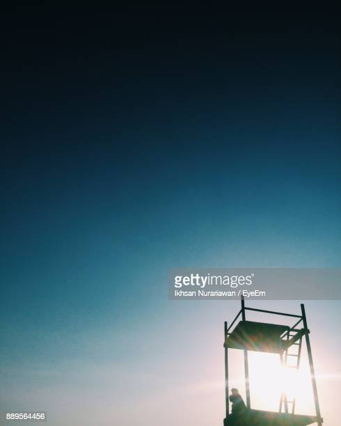 Low Angle View Of Silhouette Observation Point Against Clear Sky
