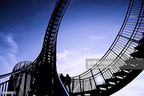 Low Angle View Of Silhouette Staircase Against Blue Sky