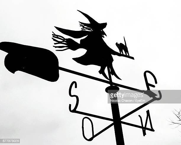Low Angle View Of Silhouette Weather Vane Against Clear Sky