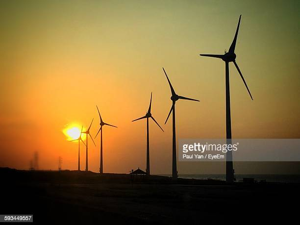 Low Angle View Of Silhouette Windmill On Field Against Sky During Sunset