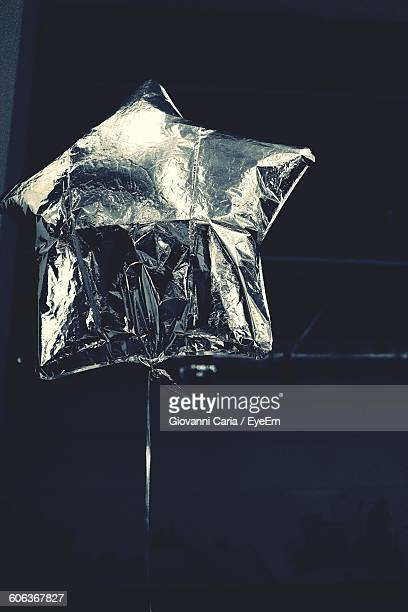 Low Angle View Of Silver Colored Helium Balloon At Music Concert