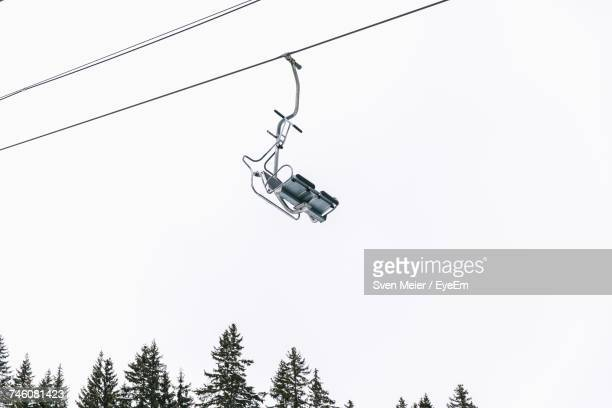 Low Angle View Of Ski Lifts Against Clear Sky