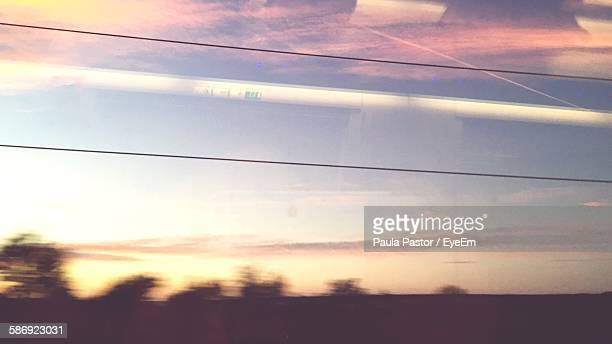 Low Angle View Of Sky Seen Through Train Window During Sunset