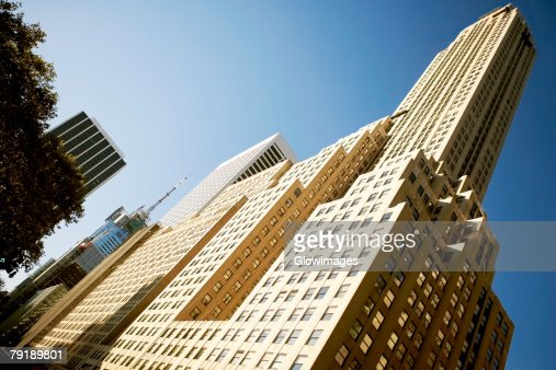 Low angle view of skyscrapers in a city, Irving Trust Company Building, Manhattan, New York City, New York State, USA : Foto de stock